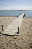 Pier; waterscape with horizon and blue sky — Stock Photo