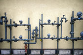 Cement wall , pipes — Stockfoto