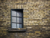 Window on an old weathered brick wall — Stok fotoğraf