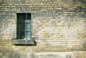 Close up of a window on weatherd brick wall — Stock Photo