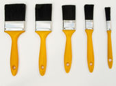 Five different sized paont brushes — Stock Photo