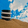Stock Photo: Five black and white stones stacked in pile
