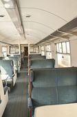 Old railway carriage with green seats — Stock Photo