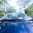 The car moves at great speed at the sunny day. - Stock Photo