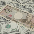 Stock Photo: Japanease 10000 yen and 100 Dollar .