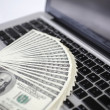 Royalty-Free Stock Photo: Computer keyboard and money
