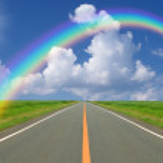Rainbow over straight road — Stock Photo