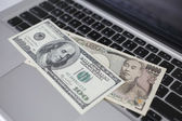 Computer keyboard and money — Stock Photo
