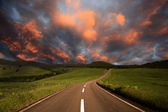 Road to burning clouds. — Stock Photo