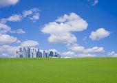 Green hill and skyscraper — Stock Photo