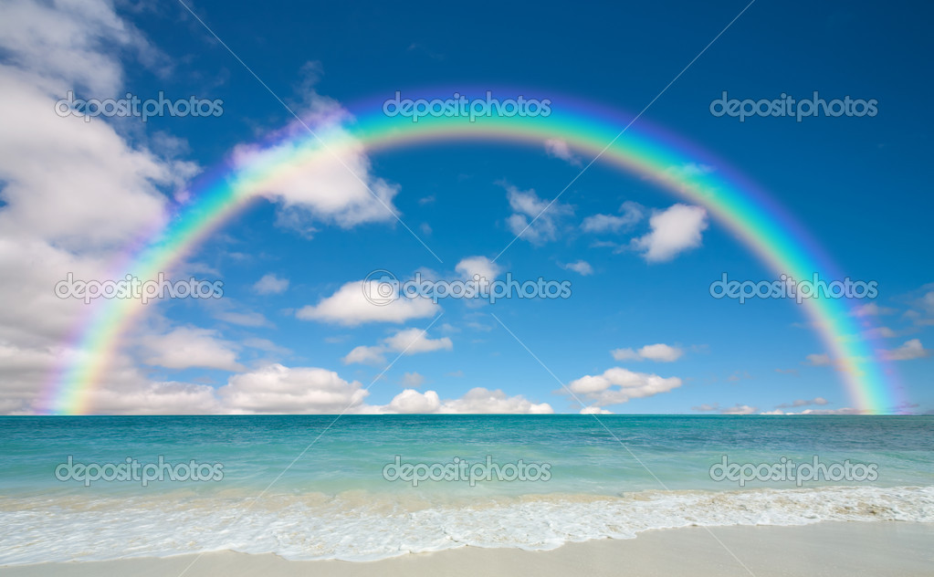 Sunny beach and rainbow — Stock Photo #8840599