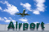 Aeroplane Clouds And Airport sign — Foto de Stock
