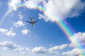 Aeroplane Clouds And Rainbow — Stock Photo