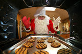 Santa in kitchen — Stock Photo