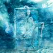 Stock Photo: Fairy girl frozen in a block of ice