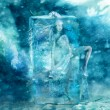 Fairy girl frozen in a block of ice — Stock Photo