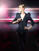 Glamorous girl in a black jacket — Stock Photo