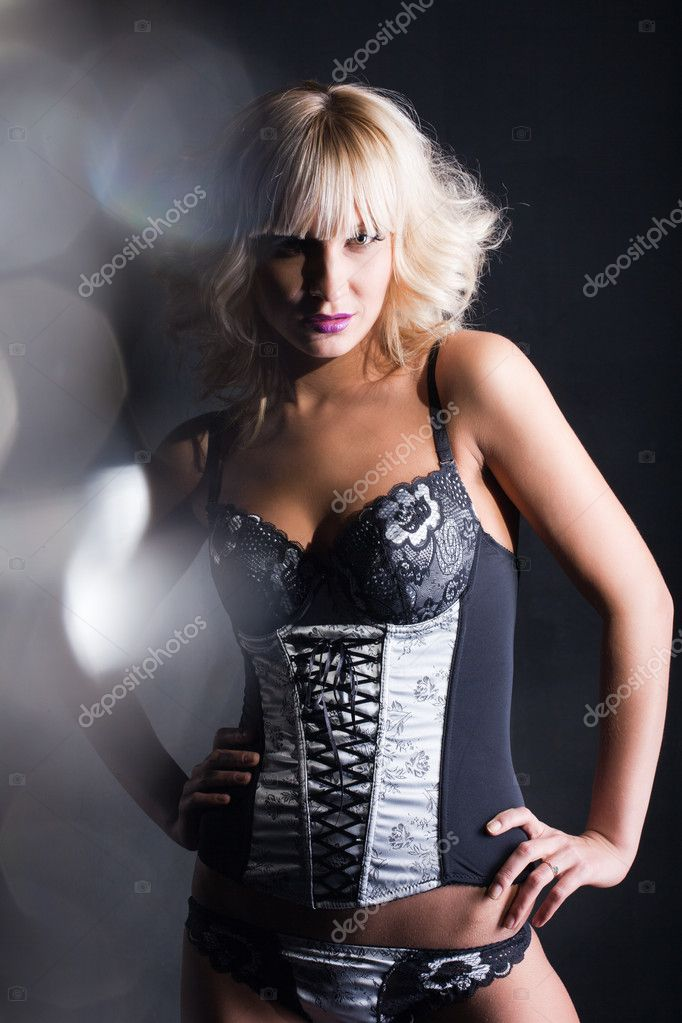 Beautiful blonde girl in a corset — Stock Photo #9178297