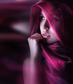 Gorgeous woman with purple color scarf — Stock Photo