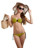Woman in yellow swimsuit — Stock Photo