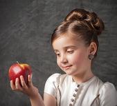 Little girl holds apple — Stock Photo