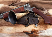 Closeup of hunter gun on fur background — Stock Photo