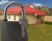 Padlock with house on background, protection of housing concept — Stock Photo