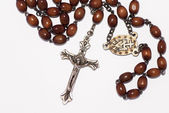 Rosary isolated over white background — Stock Photo
