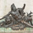 Men with lion sculpture of the Place Bellecour, Lyon, France — Stock Photo