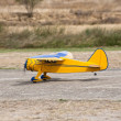Remote controlled yellow airplane — Stock Photo