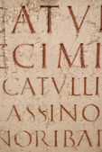 Ancient latin script carved into marble. Ruins at Lyon, France — Stock Photo