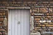 White Door with stone — Stock Photo
