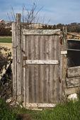 Rural outside wood door — Stock Photo