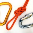 Climbing equipment - carabiners and knot - Stock Photo