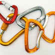 Climbing equipment - five multicolor carabiners - Stock Photo