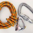 Climbing equipment - carabiners and rope - Stock Photo