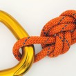Climbing equipment - carabine and knot - Stock Photo