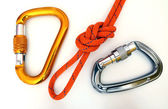 Climbing equipment - carabiners and knot — Stock Photo