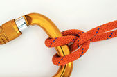 Climbing equipment - carabiner and knot — Stock Photo