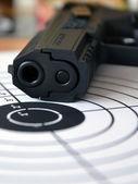 Gun and target — Stock Photo