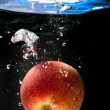 Apple in water — Stock Photo #9221472