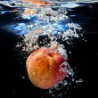 Apple in water — Stock Photo