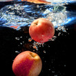 Two apple in water — Stock Photo
