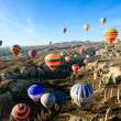 Hot air ballooning over the valley at Cappadocia, Turkey — Stock Photo