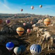 Hot air ballooning over the valley at Cappadocia, Turkey — Stok fotoğraf