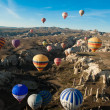 Hot air ballooning over the valley at Cappadocia, Turkey - Stock Photo