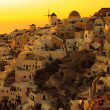 Stock Photo: Sunet shins white buildings, turning them from white to golden orange in