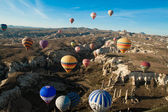 Hot air ballooning over the valley at Cappadocia, Turkey — Stock Photo