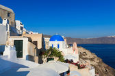 A nice round sharped and blue headed temple at Oia, Santorini, Greece — Stock Photo
