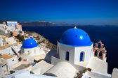 Two lovely round sharped and blue headed temples at Oia, Santorini, Greece — Stock Photo